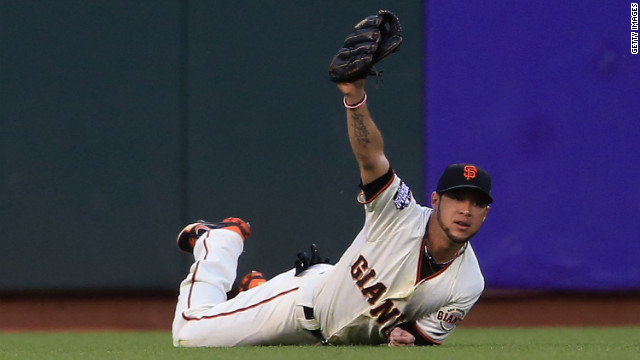 Gregor Blanco of the San Francisco Giants makes a diving catch in left field during the third inning.