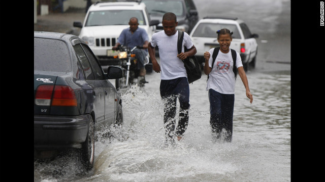 Students walk in floodwater from Hurricane Sandy's rain in Santo Domingo, Dominican Republic, on Wednesday.