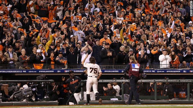 Barry Zito of the San Francisco Giants waves to the crowed as he walks to the dugout after being relieved by Tim Lincecum in the sixth inning.