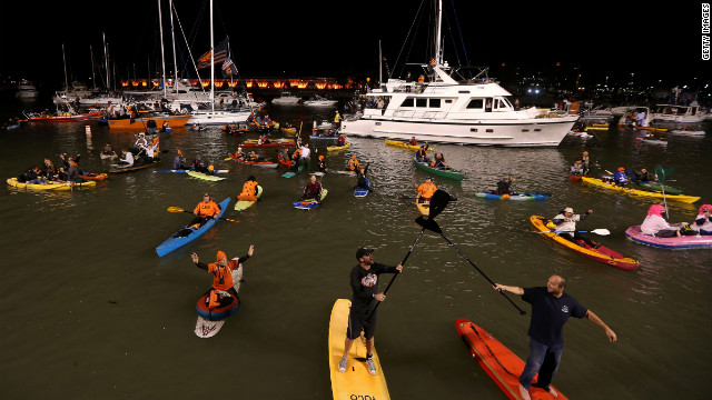 Giants fans cheer on boats and kayaks from McCovey Cove outside of AT&T Park.