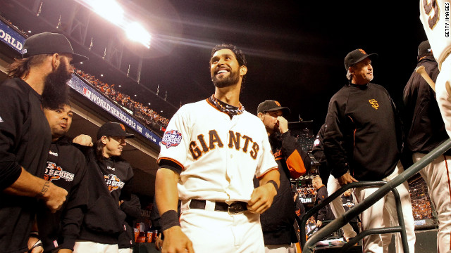 Angel Pagan of the San Francisco Giants smiles in the dugout near the end of Game 1 against the Detroit Tigers on Wednesday.
