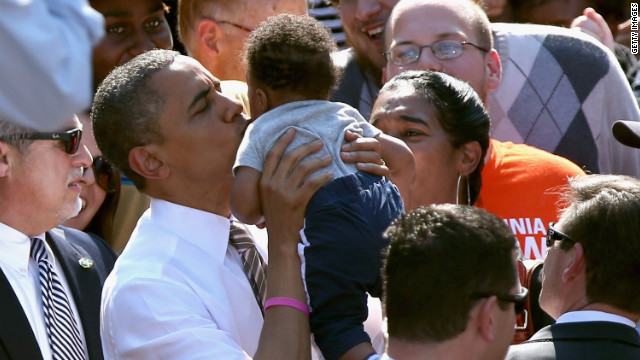 Obama kisses a baby during a campaign rally at Byrd Park in Richmond, Virginia, on Thursday.