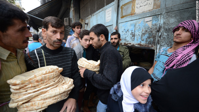 People crowd around a bakery in the Salaheddin district of Aleppo, Syria, on October 25,