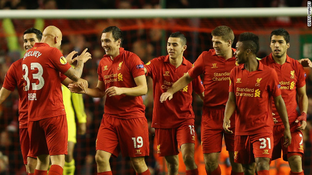 Stewart Downing (19) is congratulated by his teammates after scoring the winner for Liverpool against Anzhi