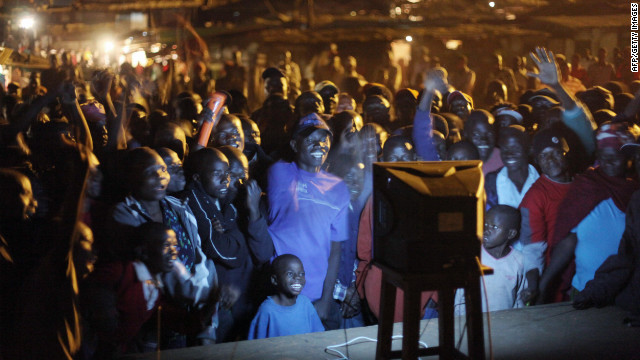 Residents of Kibera, Kenya's biggest slum, gather to watch Obama's inauguration ceremony in 2009. Mathiu says that in Kibera, Obama's story resonates strongly because when you are poor, &quot;the only thing keeping you going is a dream.&quot;