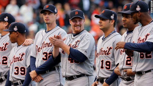 Phil Coke, center, and the Detroit Tigers are introduced before the start of the game.