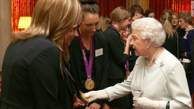 The queen meets British Olympians at a reception hours before two athletes had their medals stolen from a London nightclub.