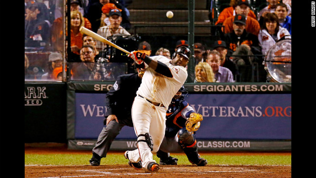 Pablo Sandoval of the San Francisco Giants hits a single in the sixth inning against the Detroit Tigers.