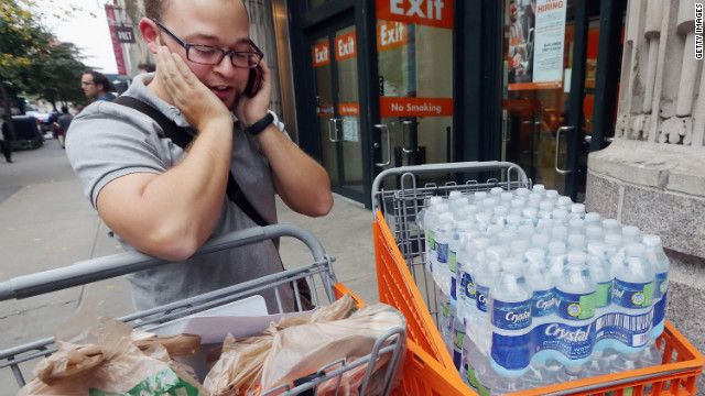 Andy Lugo stocks up in anticipation of Hurricane Sandy on Friday, October 26, in New York.