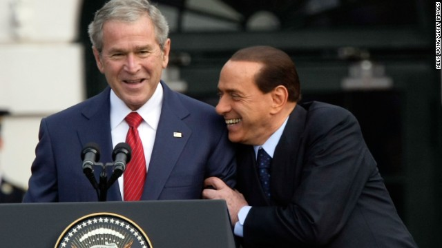 Former President George W. Bush and Berlusconi share a moment during a South Lawn arrival ceremony at the White House on October 13, 2008.
