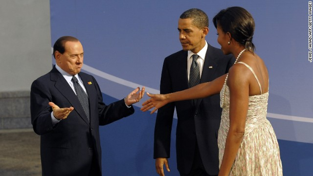 President Barack Obama and first lady Michelle Obama welcome Berlusconi to the G20 dinner in Pittsburgh, Pennsylvania, on September 24, 2009.