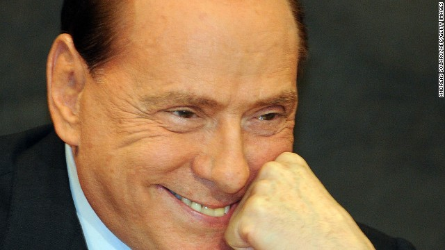 Berlusconi reacts during the presentation of politician Antonio Razzi's book &quot;Le mie mani pulite&quot; (My clean hands) at the Italian parliament in Rome on February 1, 2012.