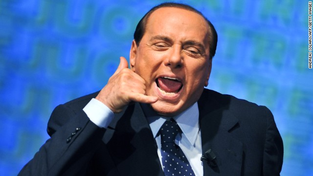 Berlusconi gestures as he takes part at a People of Freedom meeting in Rome on September 9, 2009.