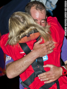Qingdao crew members, David Hall and Joanna Sandford, embrace after arriving in Western Australia. &quot;You learn a lot about the people on board -- it's human interaction on a really deep level,&quot; said sailor Lisa Blair.