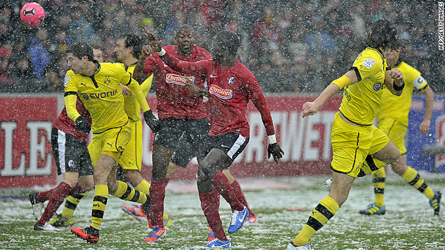 Neven Subotic (right) scores Dortmund's opening goal against Freiburg on Saturday.