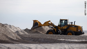 A bulldozer moves sand to help protect the shoreline in Long Beach, New York.