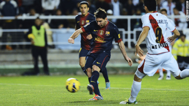 Barcelona star Lionel Messi scores his first goal during the 5-0 victory at Rayo Vallecano on Saturday.