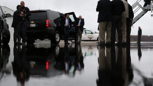 Romney emerges from his SUV at Akron-Canton Regional Airport on Saturday in Canton, Ohio.