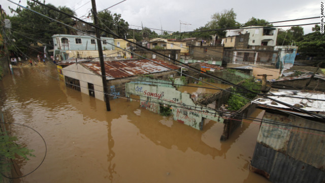 Houses are flooded out in the neighborhood of La Javilla in Santo Domingo, the capital of Dominican Republic, on Friday, October 26.
