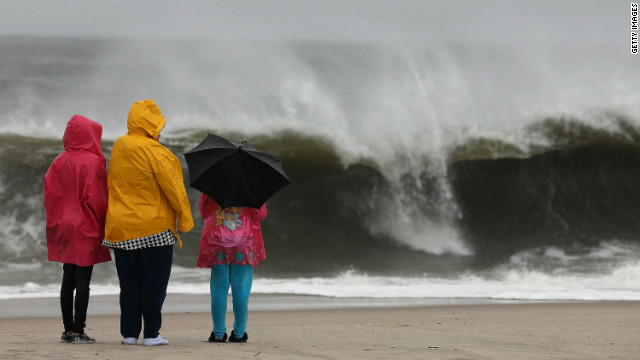 People watch the heavy surf caused by approaching Hurricane Sandy on October 28, 2012, in Cape May, New Jersey.