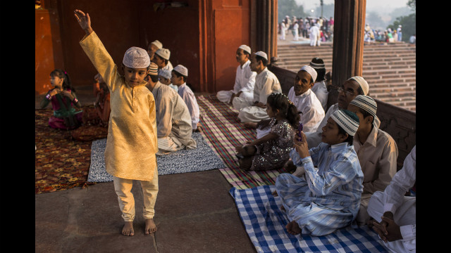  A boy poses for a photograph as Indian Muslims gather for Eid al-Adha prayers at the Jama Masjid mosque in New Delhi on Saturday.