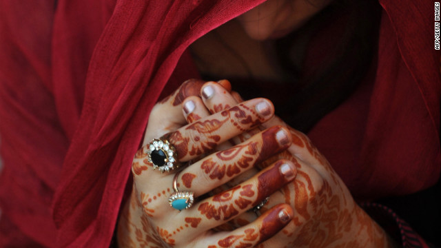A woman prays during Eid prayers at the Badshahi Mosque in Lahore, Pakistan, on Saturday, October 27. Eid al-Adha, or the Feast of Sacrifice, marks the end of the annual Hajj pilgrimage to Mecca, Saudi Arabia, and honors the Prophet Ibrahim's willingness to sacrifice his son, Ishmael, on the order of God, who according to the religion then provided a lamb in the boy's place. More than 2 million Muslims make the annual Hajj pilgrimage to Mecca, which is one of the five pillars of Islam.