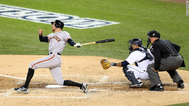 Hunter Pence of the Giants hits a ground-rule double to centerfield against Max Scherzer of the Tigers in the second inning.