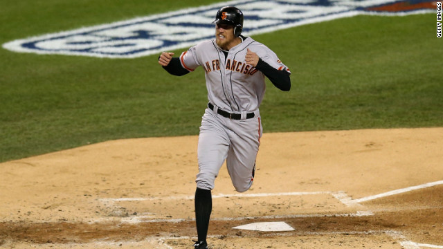 The Giants' Hunter Pence celebrates after scoring a second-inning run Sunday, thanks to teammate Brandon Belt's RBI triple.