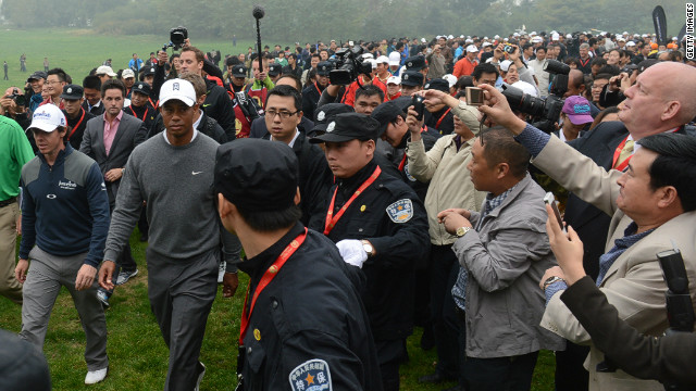 """The scene was barely-controlled chaos,"" <a href='http://blogs.golf.com/presstent/2012/10/tiger-woods-rory-mcilroy-set-for-duel-in-china.html' target='_blank'>wrote Sports Illustrated's Alan Shipnuck</a>. ""Some 3,000 fans streamed across the fairways, with soldiers locking arms in a human fence to keep the throngs off the greens."""