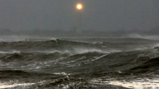 Cape May Lighthouse shines over the heavy surf.