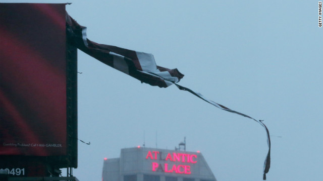 A tattered piece of a billboard blows in the wind Monday in Atlantic City, New Jersey. 