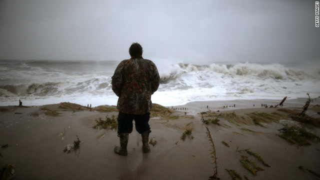 Andy Becica watches the heavy surf from Hurricane Sandy wash in Monday at Cape May, New Jersey. The full force of Hurricane Sandy is expected to hit the New Jersey coastline later Monday.