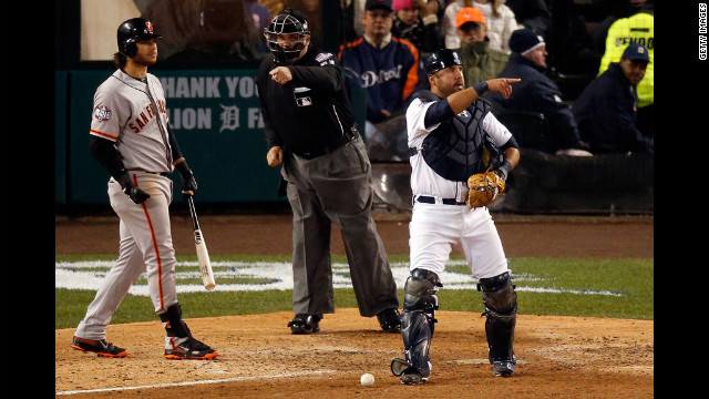 Gerald Laird of the Detroit Tigers points to third base after a play in the seventh inning against the Giants.