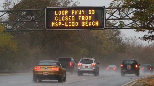 An overhead sign on the Southern Parkway alerts motorists to road closings in Wantagh, New York, on Monday.