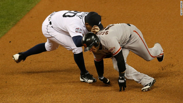 Marco Scutaro of the Giants gets tagged by Octavio Dotel of the Detroit Tigers in the eighth inning.