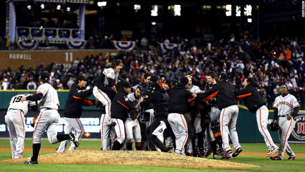 The San Francisco Giants celebrate after the team beat the Detroit Tigers in 10 innings to win the World Series on Sunday, October 28, at Comerica Park in Detroit. The Giants defeated the Tigers 4-3 to sweep the series in four games. <a href='http://www.cnn.com/2012/10/27/worldsport/gallery/world-series-game-3/index.html'>See the best photos of Game 3 here</a>.
