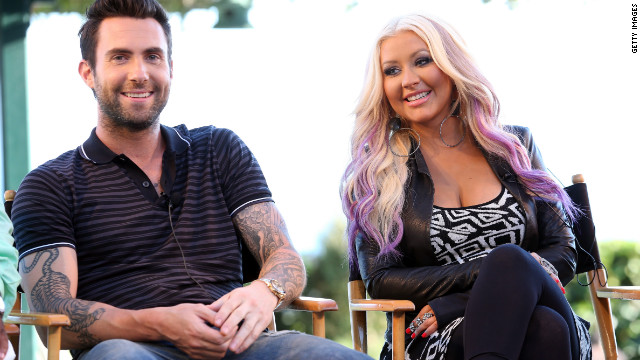 Adam Levine defends Christina Aguilera against critics