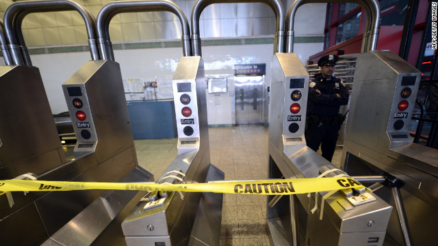 A New York City police officer stands guard at the 42nd Street subway station in Times Square on Monday.