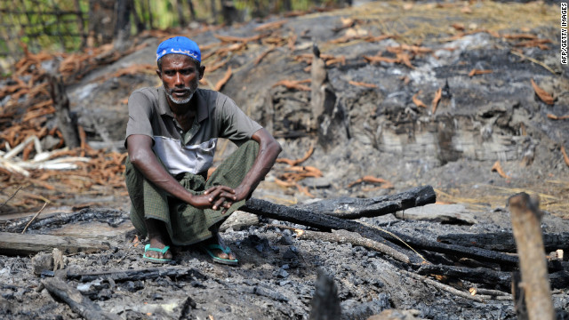 A Muslim Rohingya man sits at the site of his burnt-out home at a village in Minpyar in Rakhine state on Sunday.The U.N. said it seen &quot;large-scale&quot; destruction of houses. 