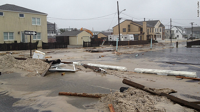 Debris covers a road in New Jersey's barrier islands as Hurricane Sandy rolls in