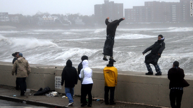 People brave high winds and waves in Winthrop, Massachusetts, as Hurricane Sandy moves up the coast on Monday.
