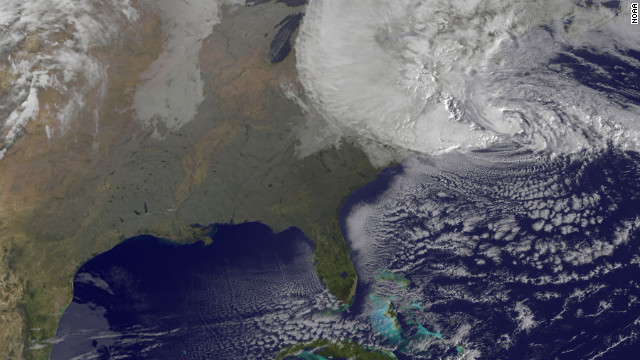 A satellite image shows Hurricane Sandy at 8:25 a.m. ET Monday. Forecasters warned that Sandy was likely to collide with a cold front and spawn a &quot;superstorm&quot; that could generate flash floods, snowstorms and massive power outages.