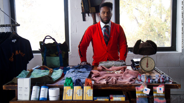 Najee Redd, store manager of <a href='http://www.sirandmadame.com/' target='_blank'>Sir & Madame</a> in Chicago, displays American-made clothing and accessories available at the store.
