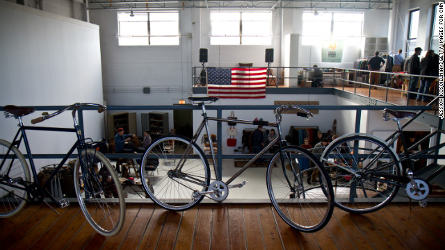 Handcrafted bicyles from Chicago's <a href='http://www.heritagebicycles.com/' target='_blank'>Heritage General Store</a>, a hybrid coffee shop and full-service bike shop, adorn the showroom.