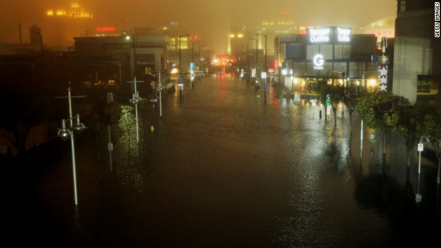 A flooded street is seen at nightfall during the storm on Monday in Atlantic City, New Jersey.