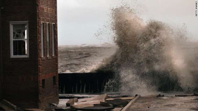 Waves break next to an apartment building in Atlantic City, New Jersey, on Tuesday.