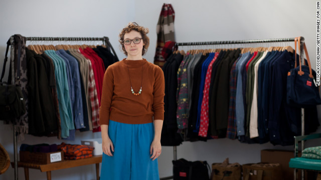 Penelope's co-owner, Jena Frey, stands among the store's collection of American-made clothing at NorthernGRADE.
