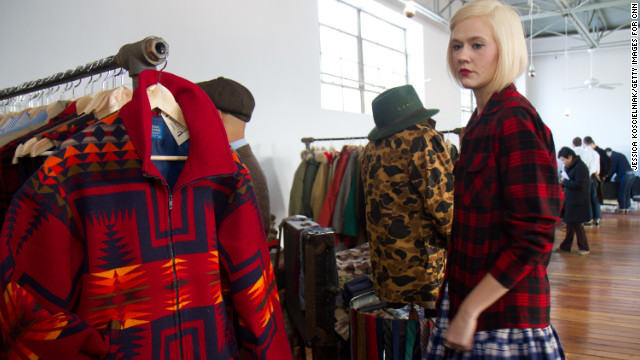 Karyn Dethrow tries on clothes at the <a href='http://midnorthmercantile.us/' target='_blank'>MidNorth Mercantile</a> boutique, which rescues and restores classic American vintage from estate sales and yard sales.