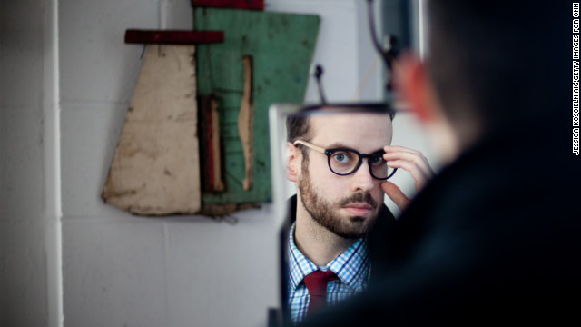 Chicagoan Joel Axelrod tries on handmade wood and acetate glasses by Drift, a Chicago-based eyewear company.