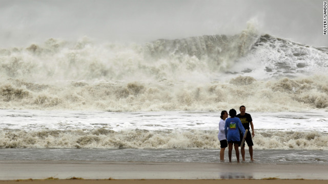 A wall of water makes its way to shore as residents brave the storm Monday in Ocean City, Maryland.